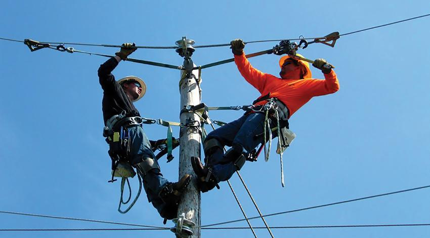 linemen on a wire