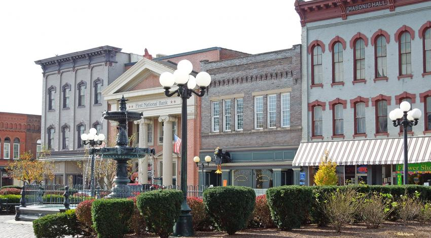 A picture of a fountain and buildings in Nelsonville