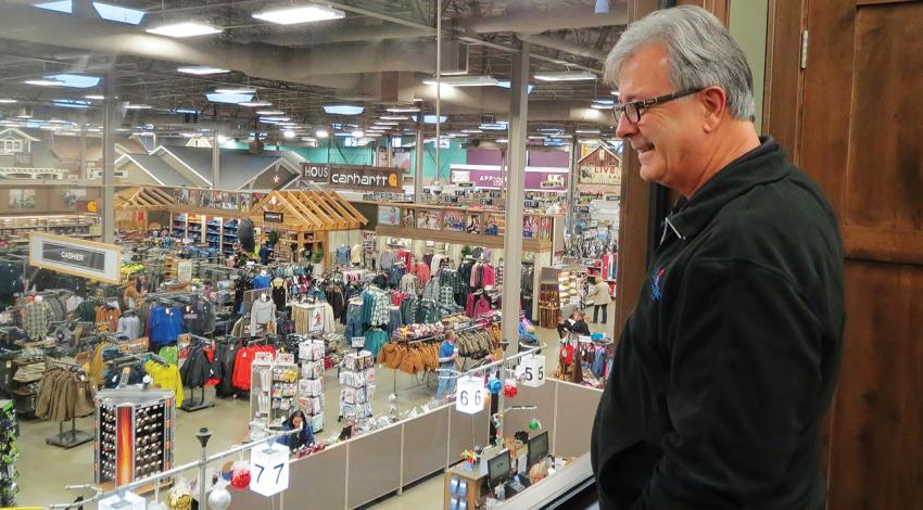 Owner Howard Miller watches customers roam the floor of his hardware store in Hartville.