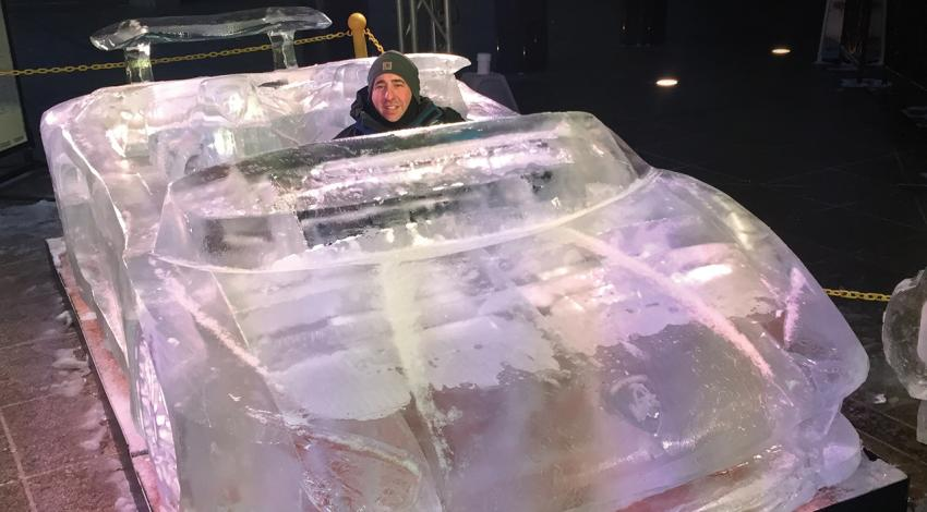 Chad Hartson sits in a 2017 Lamborghini he carved out of ice.