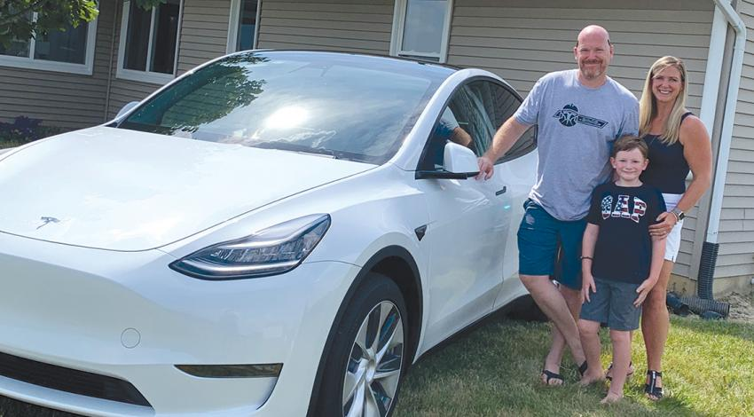 Huber family with their Tesla model Y